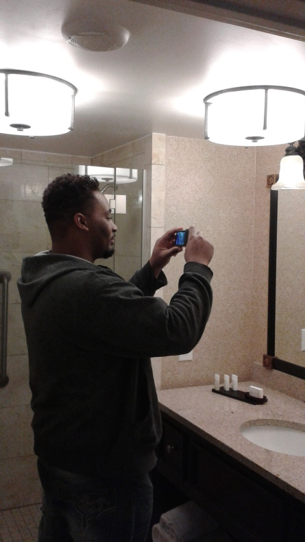 My brother...taking a picture of himself taking a picture in the hotel bathroom
