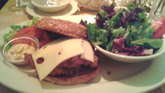 Dinner at The Cheesecake Factory; spicy chicken sandwich with a raspberry vinaigrette drizzled salad. Yum!