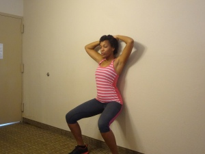 Wall sits (or wall squats) work your abdominal muscles and your legs.